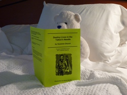 A white bear reads the chapbook for Destiny Lives in the Tattoo's Needle